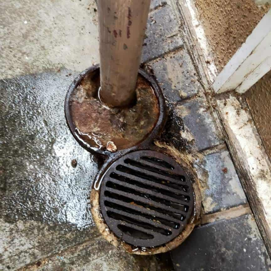 blocked drain with pooling muddy water
